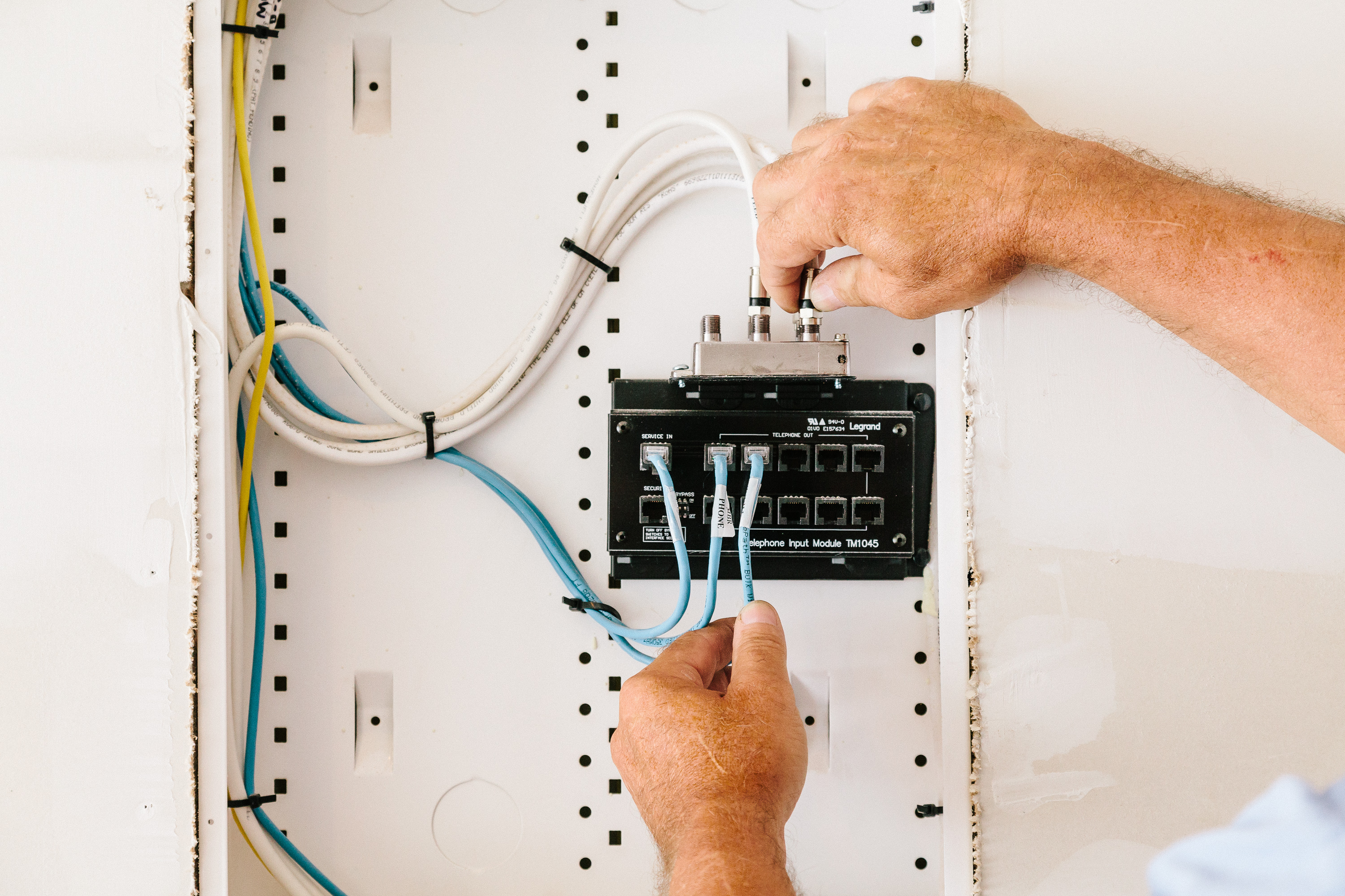 image of sescos electrician installing a communication link