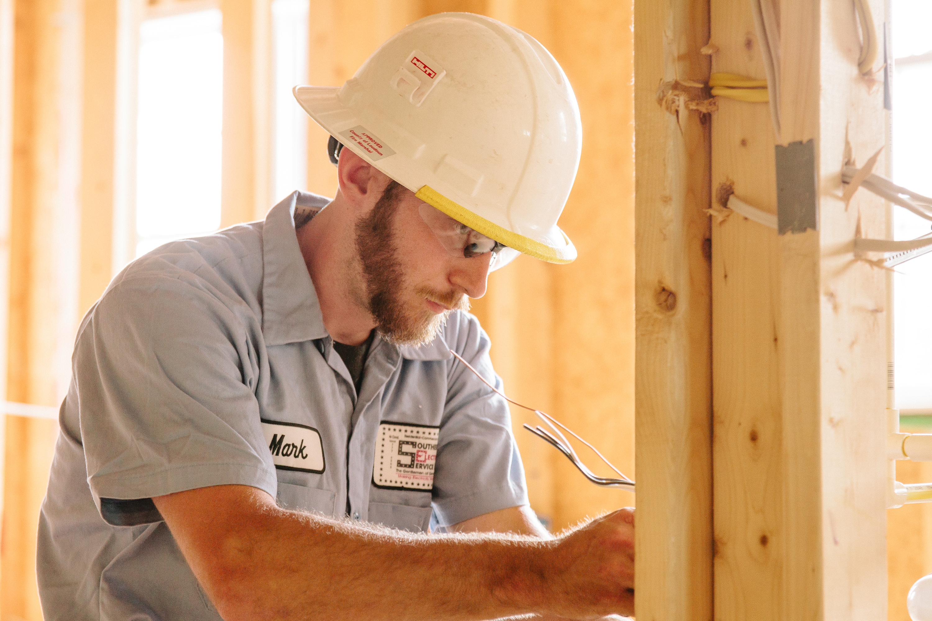 Image of SESCOS electrician installing wiring