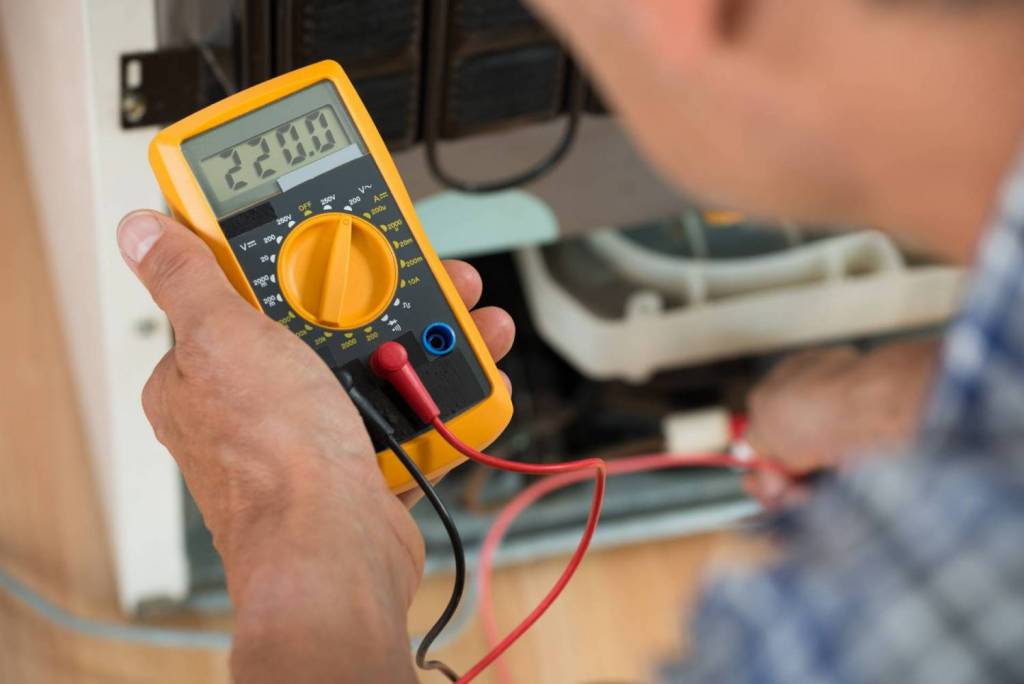 Image of Professional Electrician Using a Multimeter